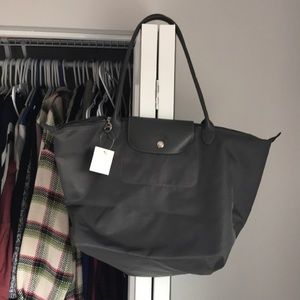 Longchamp Large Grey Le Pliage Tote, has marks
